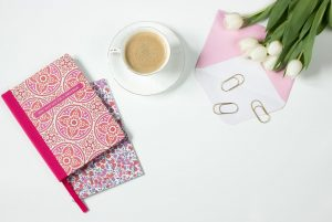coffee flowers notebook work desk
