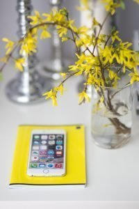 kaboompics White smartphone with yellow flowers